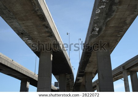 Urban highway viaducts perspective against the blue sky. - stock photo