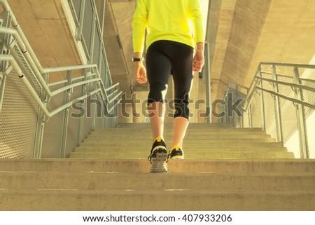 Urban jogger exercising on a big bridge - staircase. - stock photo