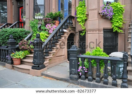Urban Lifestyle Brooklyn New York Brownstone Entrance Steps with Summer Blooming Plants - stock photo