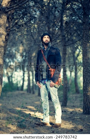 urban man relaxing in forest - stock photo