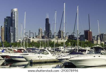 Urban marina skyline: Yachts in Burnham Harbor in Chicago, Illinois, USA, with landmarks (including Willis Tower, once the tallest building in the world) in the distance, early in June - stock photo