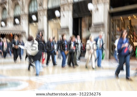 Urban move, people walking in city, motion blur, zoom effect