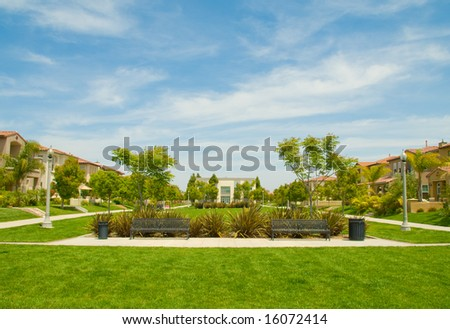 Urban Park Among Houses - stock photo