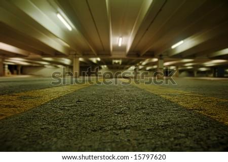 Urban parking garage at night. - stock photo