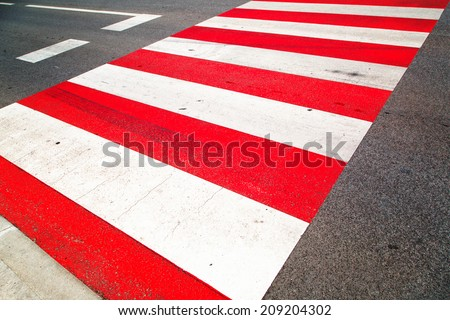 Urban red colored road crossing background. - stock photo