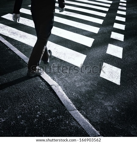 Urban road crossing with pedestrian. - stock photo