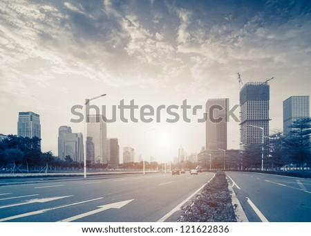 Urban road in the evening - stock photo