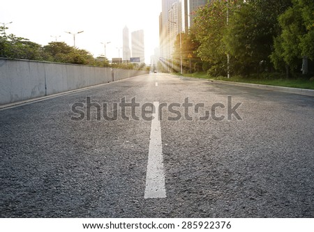 Urban road with sunset - stock photo