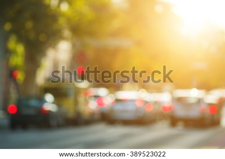 Urban scene with cars and traffic lights on a sunny day