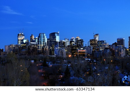 Urban skyline of Calgary at night with office towers in urban centre.