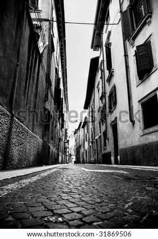 Urban slum. Narrow Italian street. High contrast black and white colors.