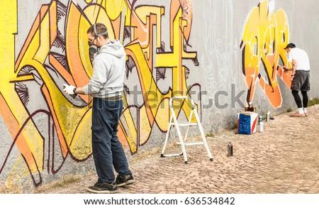 Urban Street Artists Painting Colorful Graffiti Stock Photo (Royalty ...