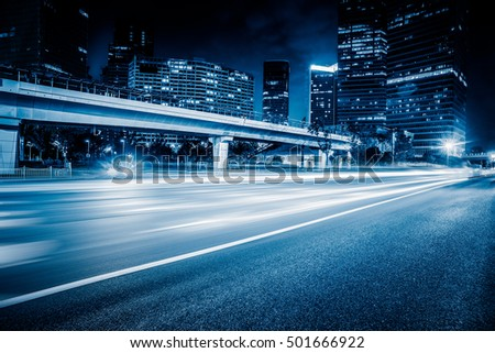 urban traffic road with cityscape at night in China.