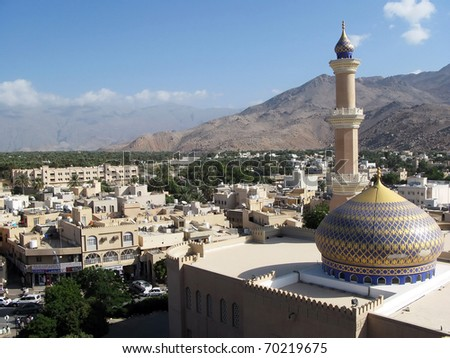 Urban view of Nizwa and a mosque, from Nizwa Fort lookout in the Sultanate of Oman in the Middle East.  - stock photo