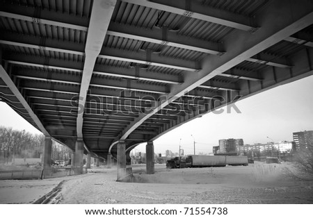 Urban view: small old bridges under modern automotive metal bridge