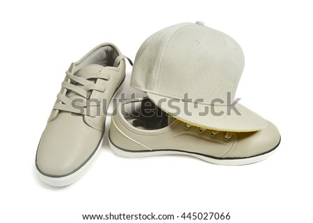 urban wear, grey sneakers and cap on a white background