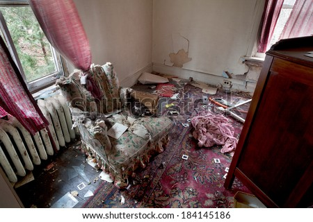 Urbex - Living room of an abandoned and dirty house in light HDR processing - stock photo