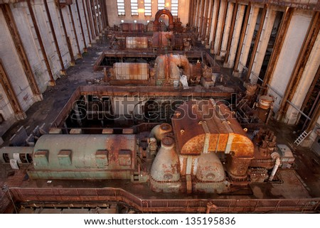 Urbex - View of an abandoned power plant's turbines, in light HDR processing - stock photo