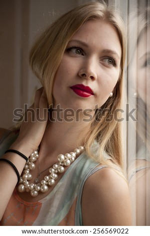 Uretouched portrait of a beautiful young blond woman - stock photo