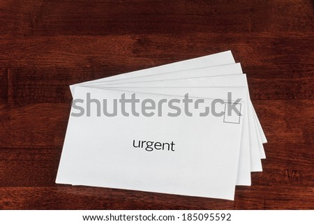 Urgent Delivery Concept with Letters in White Envelope   - stock photo