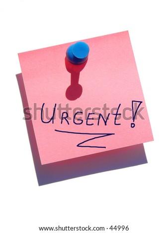 Urgent note on white background - stock photo