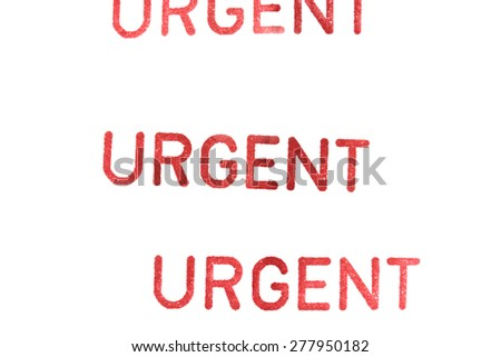 urgent rubber stamp on paper - stock photo