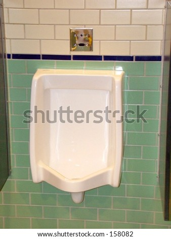Urinal in clean public bathroom - stock photo