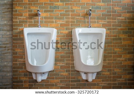 Urinal in the toilet of a restaurant. - stock photo
