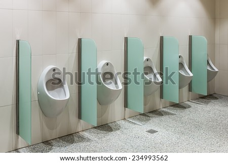 urinals in a public toilet, background - stock photo