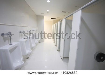 Urinals in commercial bathroom. - stock photo
