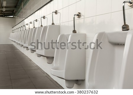 Urinals in the men's bathroom with white ceramic urinals design of white men in the toilet. - stock photo