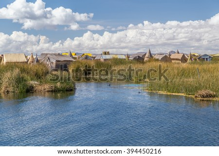 Uros floating island and village on Lake Titicaca near Puno, Peru - stock photo
