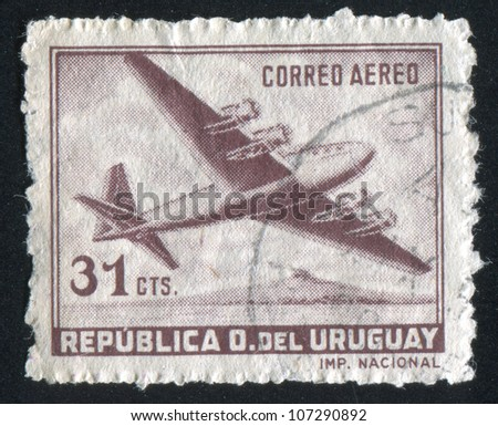URUGUAY - CIRCA 1947: A stamp printed by Uruguay, shows Four-Motored Plane, circa 1947 - stock photo