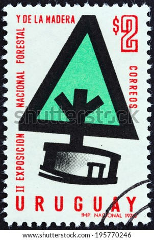 URUGUAY - CIRCA 1970: A stamp printed in Uruguay issued for the 2nd anniversary of the National Forestry Exhibition shows Stylized Tree, circa 1970.  - stock photo