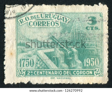 URUGUAY - CIRCA 1950: stamp printed by Uruguay, shows Cannon, Rural and Urban Views, circa 1950