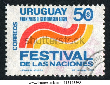 URUGUAY - CIRCA 1973: stamp printed by Uruguay, shows Emblem of Social Coordination Volunteers, circa 1973 - stock photo