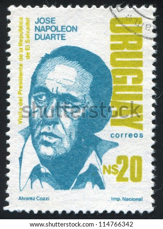 URUGUAY - CIRCA 1987: stamp printed by Uruguay, shows Jose Napoleon Duarte, President of El Salvador, circa 1987 - stock photo
