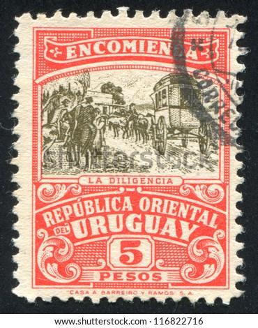 URUGUAY - CIRCA 1946: stamp printed by Uruguay, shows Mail Coach, circa 1946 - stock photo