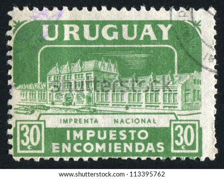 URUGUAY - CIRCA 1960: stamp printed by Uruguay, shows National Printing Works, circa 1960 - stock photo