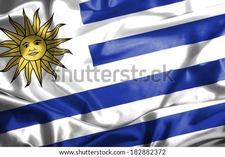 Uruguay waving flag - stock photo