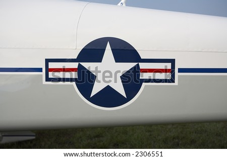 US Airforce Insignia on Fusalodge of Plane - stock photo