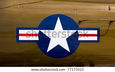 US airforce stars and stripes on side of old fighter aircraft - stock photo