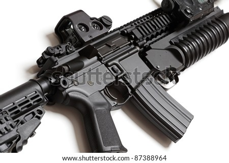 US Army assault carbine with grenade louncher close-up. Isolated on a white background. Weapon series. - stock photo