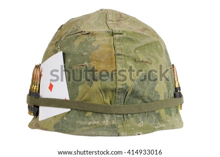US Army helmet Vietnam war period with camouflage cover and ammo belt  and amulet - playing card ace of diamonds