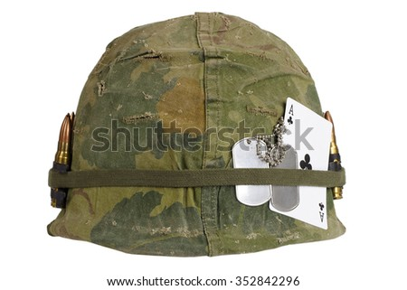 US Army helmet Vietnam war period with camouflage cover and ammo belt, dog tag and amulet - ace of clubs playing card