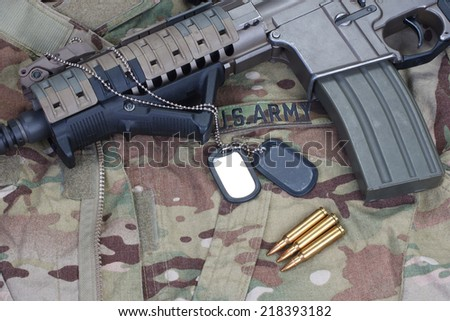 us army special forces uniform and weapon concept background - stock photo