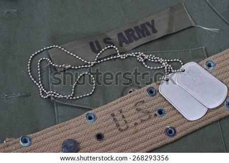 us army uniform with blank dog tags background - stock photo