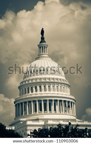 US Capitol Building dome detail in clouds - Split toned - stock photo
