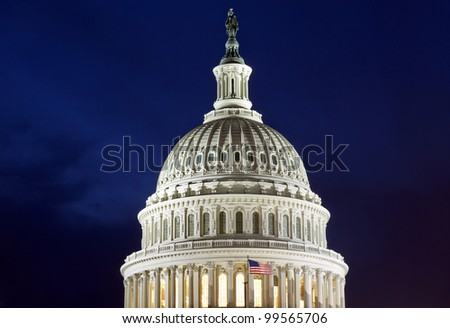 US Capitol Building Dome detail with American Flag, at dusk, Washington DC, United States - stock photo