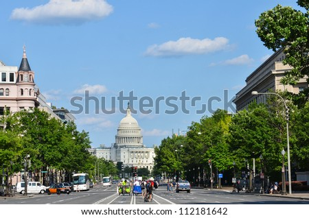 US Capitol building from Pennsylvania Avenue with car traffic foreground - Washington DC United States - stock photo